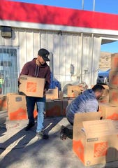 Volunteers unload Santa's Helpers boxes at Hondo.