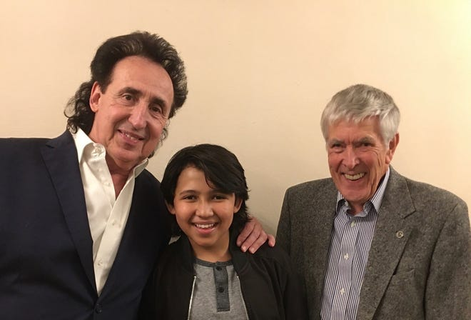 Flutist Alexander Zonjic, child prodigy piano player Justin Shultz, and concert organizer Malcolm Hendy of the Senior Men's Club at the Birmingham Community House share a moment together prior to the Elegant Evening with Alexander Zonjic concert.