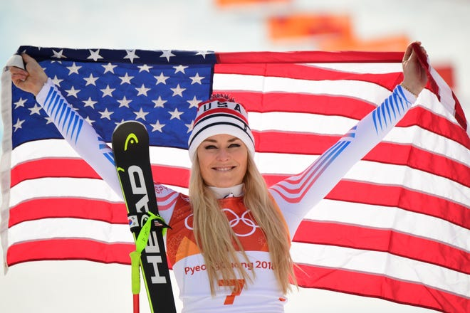 Lindsey Vonn celebrates during the victory ceremony of the women's Downhill at the Jeongseon Alpine Center during the Pyeongchang 2018 Winter Olympic Games on February 21, 2018.