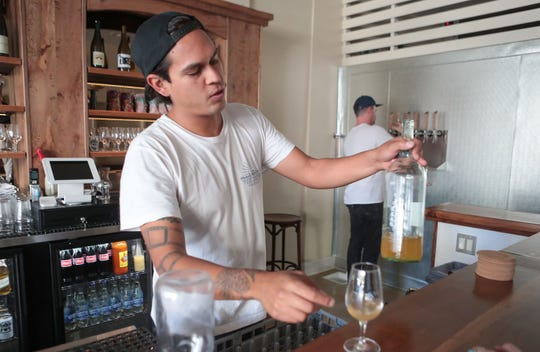 Rey Romero pours a wine at the Las Palmas Brewery in downtown Palm Springs, November 8, 2019.