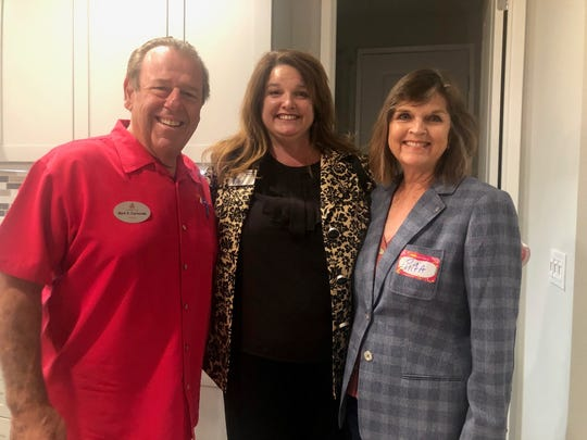 Cathedral City mayor Mark Carnevale joins Kimberly Krause of the Greater Coachella Valley Chamber of Commerce and Cathedral City city council member Rita Lamb join for a photo op.