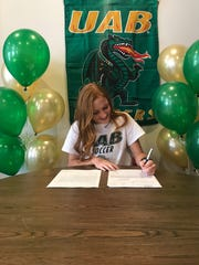 Gulf Breeze soccer standout Kristen Goodroe inks her letter of intent to sign with UAB.