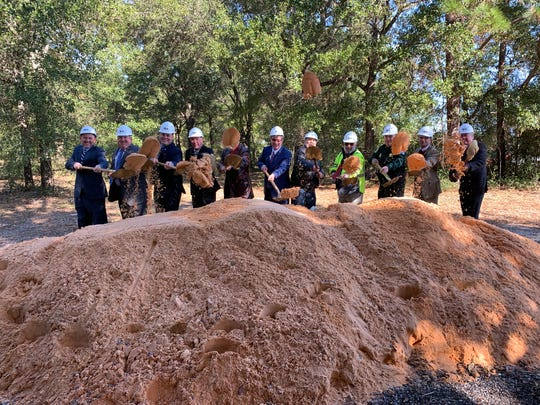 Santa Rosa County leaders and members of the building and design teams selected to construct the new Santa Rosa County Courthouse break ground at the new location on Avalon Boulevard in Milton on Wednesday.
