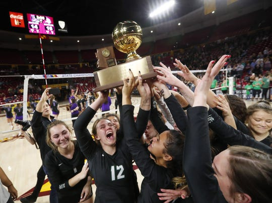 Sunnyslope players celebrate after winning the 5A state volleyball championship against Millennium at Desert Financial Arena in Tempe November 12, 2019.
