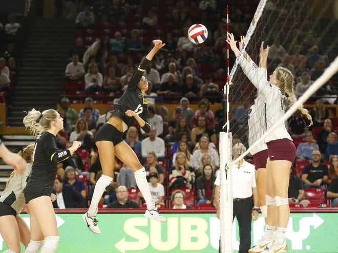 Basha's Jaelyn Hodge (12) hits a shot against Perry during the 6A state volleyball championship game at Desert Financial Arena in Tempe November 12, 2019.