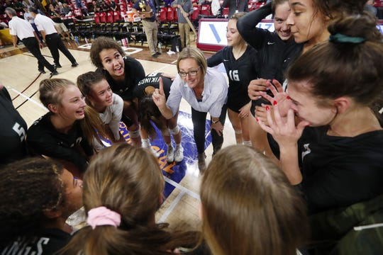 Sunnyslope head coach Amber LeTarte talks to her players after winning the 5A state volleyball championship against Millennium at Desert Financial Arena in Tempe November 12, 2019.