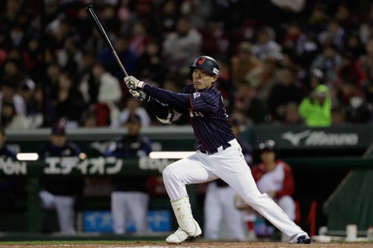 Outfielder Shogo Akiyama #55 of Japan hits an inside-the-park home run in the top of 8th inning during the game four between Japan and MLB All Stars at Mazda Zoom Zoom Stadium Hiroshima on November 13, 2018 in Hiroshima, Japan.