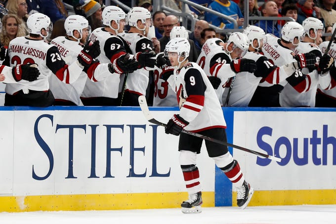 Arizona Coyotes' Clayton Keller (9) is congratulated by teammates after scoring during the second period of an NHL hockey game against the St. Louis Blues Tuesday, Nov. 12, 2019, in St. Louis. (AP Photo/Jeff Roberson)
