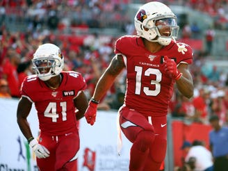 Cardinals receiver Christian Kirk (13) celebrates after scoring a touchdown against the Buccaneers on Nov. 10 at Raymond James Stadium.