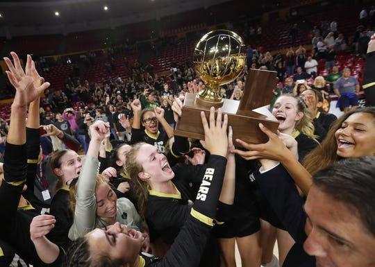 Basha players celebrate after winning the 6A state volleyball championship against Perry at Desert Financial Arena in Tempe November 12, 2019.