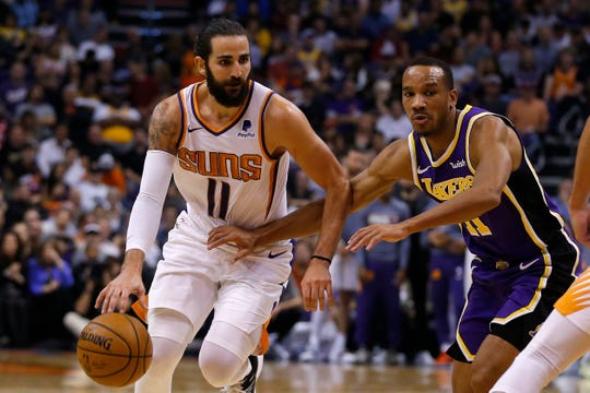 Phoenix Suns guard Ricky Rubio drives past Los Angeles Lakers guard Avery Bradley (11) during the second half of an NBA basketball game Tuesday, Nov. 12, 2019, in Phoenix. (AP Photo/Rick Scuteri)