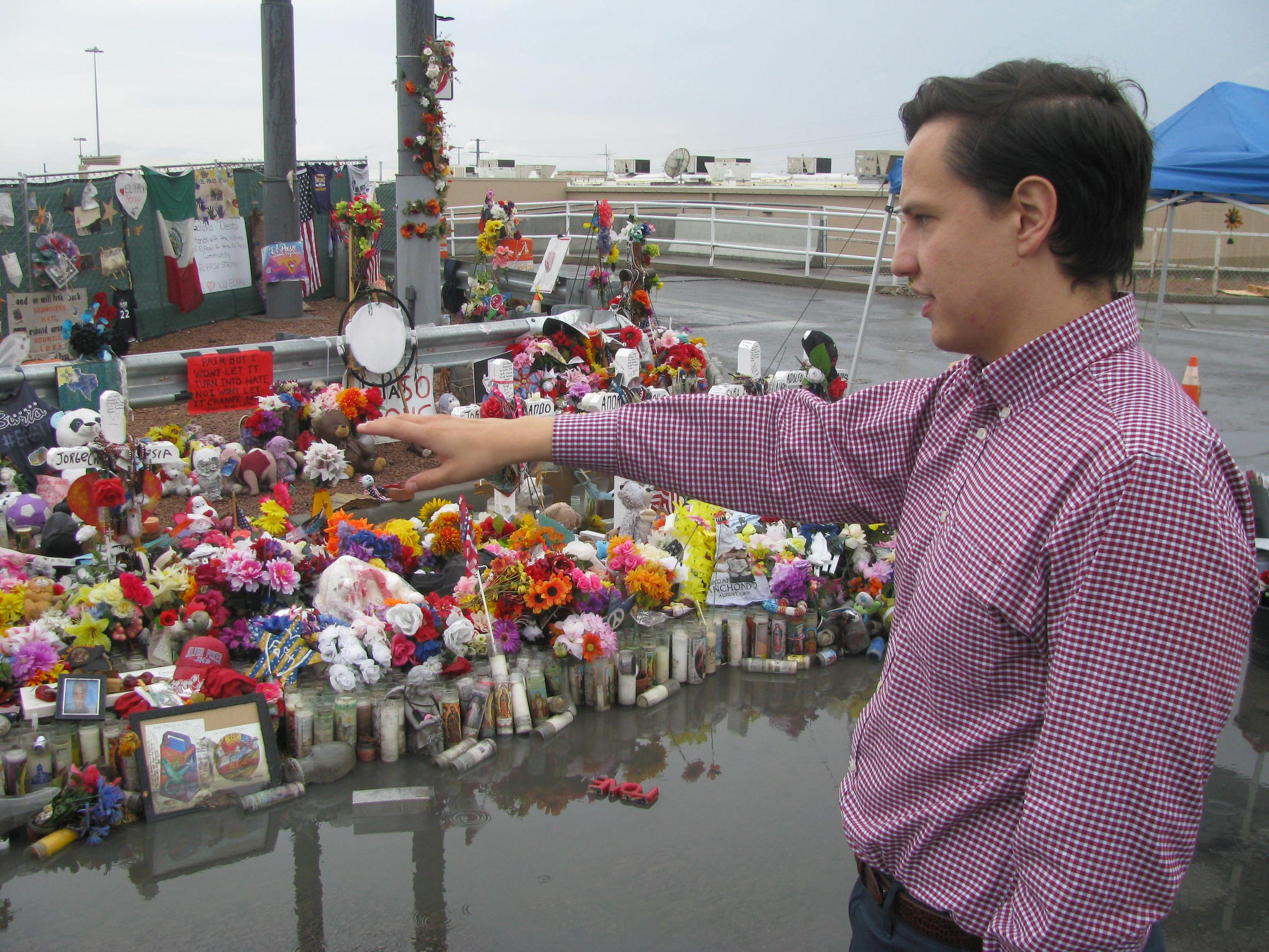 Adrian Broaddus visits the memorial behind an El Paso Walmart on Oct. 4, 2019.