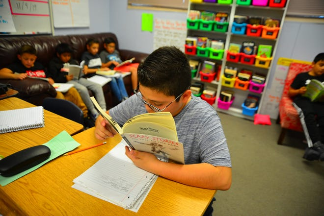 Sixth-grader Diesel Diaz reads independently in Elsa Dean's class at Whittier Elementary on Nov. 4, 2019.