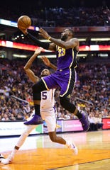 Los Angeles Lakers forward LeBron James (23) drives to the basket past Phoenix Suns forward Mikal Bridges (25) in the second half on Nov. 12, 2019 in Phoenix, Ariz.