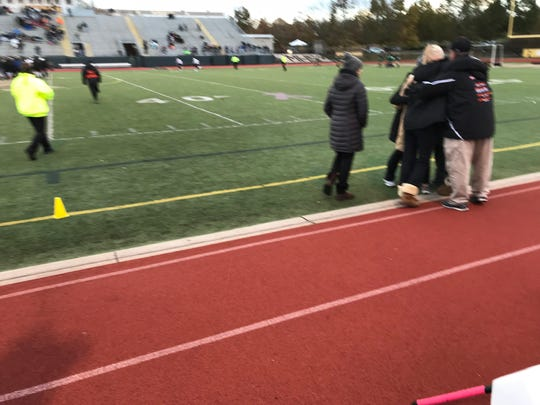 The Palmyra field hockey team's coaches get together for a group hug following Tuesday's state semifinal win over Twin Valley.