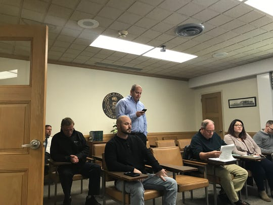 Lebanon County Republican Party chairman Casey Long reads from his phone while requesting a recount at Wednesday's election board meeting.