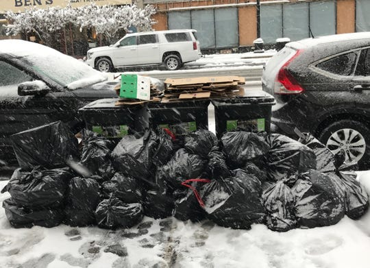 A recent pile of trash awaiting pickup along Huron Avenue in downtown Port Huron. The city announced in November 2019 it was launching a pilot dumpster-share program to help reduce the issue for a growing downtown.