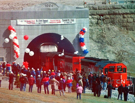 Dignitaries and railroad fans greet the first CN locomotive to pass through the new St. Clair River International Train tunnel as it reaches Port Huron at 3 p.m. May 6, 1995.