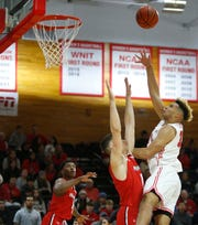 Marist's Zion Tordoff takes a jump shot as Hartford's Romain Boxus covers him during Tuesday's home opener on November 12, 2019.