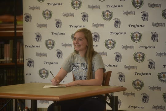 Taylor Pearce signs her National Letter of Intent to play lacrosse at Thiel College at Chambersburg Area Senior High School on Nov. 13, 2019.