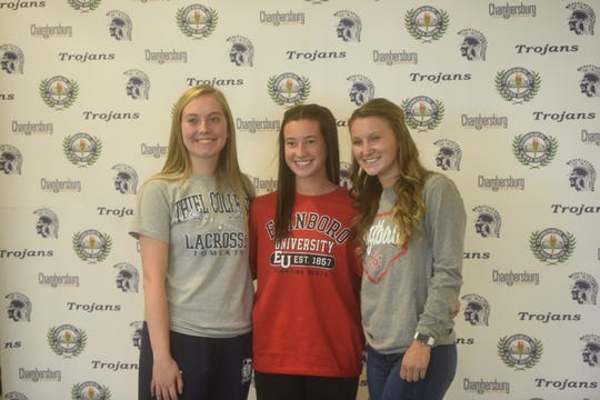 Taylor Pearce, Layne Kimple and Taylor Myers (L-R) all signed National Letters of Intent to play collegiate sports on Wednesday afternoon at Chambersburg Area Senior High School.