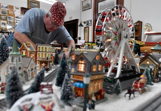 Don McCully of Dover, a member of the Red Lion Train Station Model Railroaders, helps set up displays in the historic Maryland & Pennsylvania Railroad's Red Lion Train Station, Tuesday, November 12, 2019. John A. Pavoncello photo