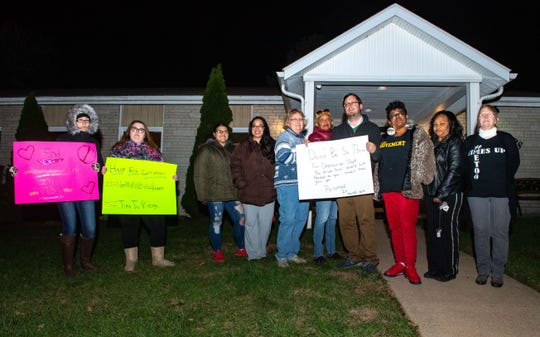 (Right to left) Sandra Hinkle, Sandra Harrison, Tonya Larry, Jason Querry, Salome Garcia-Johnson, Mary Somervall, Mildred Tavarez, Wales Rivera, Ashley Stine and Shasta Markle stand and picket in front of the North York Borough Office in a protest to end discrimination and harassment in the North York Borough, November 12, 2019.