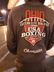 After winning the championship at the Ohio Eastern Elite Qualifier event, Antwoine displays his championship hoodie.