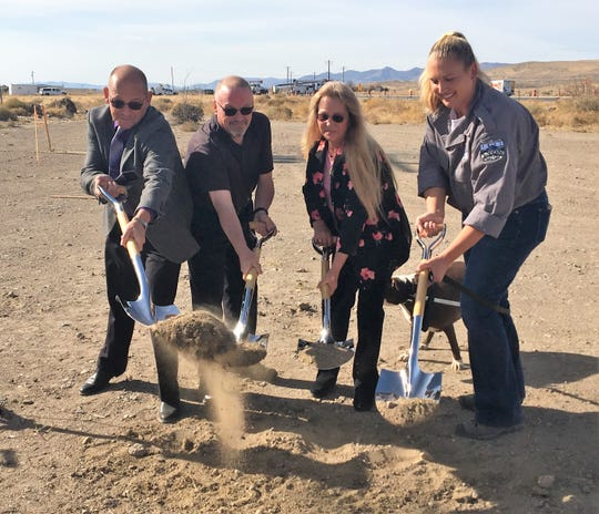 County Manager Jeff Page, commissioners Bob Hastings and Vida Keller, and Animal Services Supervisor Nicole Cates turn dirt during a groundbreaking ceremony for the new shelter.
