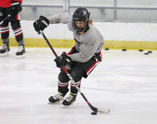 Caroline Harvey heads up ice with the puck during their Bishop Kearney Selects Academy U19 practice Tuesday, Nov. 12, 2019 at Bill Gray's Regional Iceplex in Brighton.