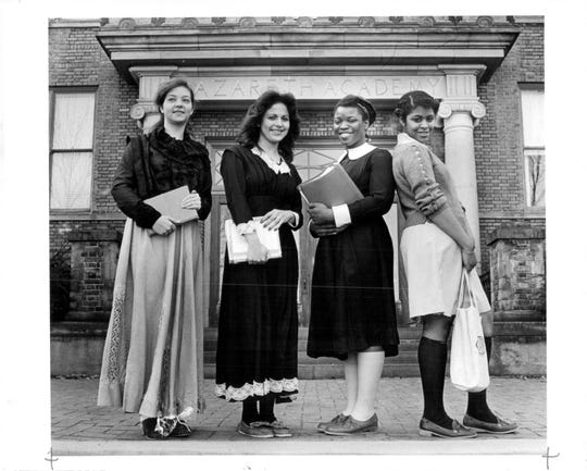 Nazareth Academy students pose in 1982 in four of the uniforms worn since the school opened. From left are Lori Bauman in a 1915 uniform; Rita Pettinaro in a 1920 uniform; Taunya Wilson in a 1940s uniform and Jacqueline Hart in the 1980s uniform.
