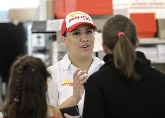 In-N-Out Burger employee Alyssa takes customers' orders at the opening of its second location in Redding on Tuesday, Nov. 12, 2019.