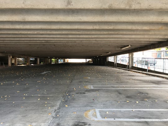 The north end of the downtown parking structure sits empty Wednesday as crews prepare to demolish it. The north end closed Monday.