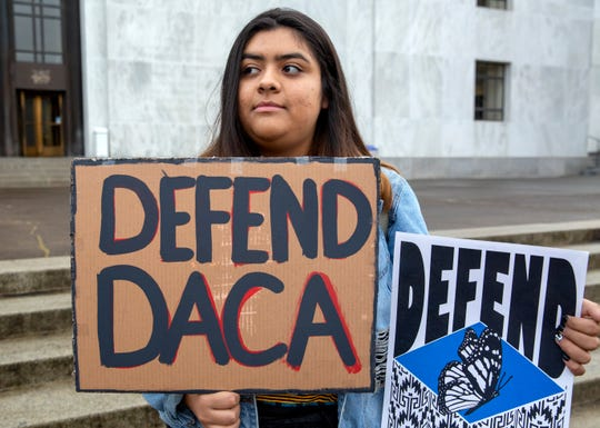 Michelle Correa, 18, from Salem, attends a rally to support immigration issues like DACA (Deferred Action for Childhood Arrivals) and TSP (Temporary Protected Status) at the Oregon State Capitol in Salem, on Nov. 12.