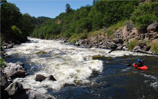 A kayaker heads into the large rapids in the Hell's Corner section of the Upper Klamath River.