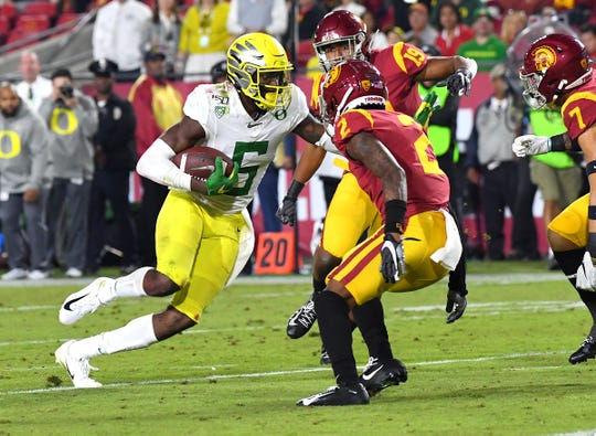 Nov 2, 2019; Los Angeles, CA, USA; Oregon Ducks wide receiver Juwan Johnson (6) carries the ball past USC Trojans cornerback Olaijah Griffin (2) to score a touchdown in the second half of the game at the Los Angeles Memorial Coliseum. Mandatory Credit: Jayne Kamin-Oncea-USA TODAY Sports