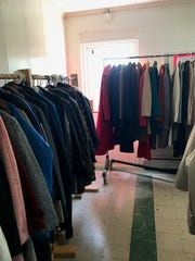 Coats hang on racks in a room at Onley United Methodist Church, ready to be distributed  at a free coat closet on Nov. 16 from 9 to 11 a.m.
