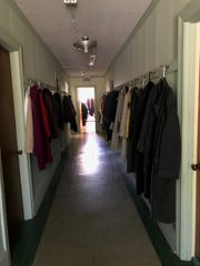Donated coats line a hallway at Onley United Methodist Church, where a free coat closet will be held on Nov. 16, Dec. 7, Jan. 4, and Feb. 1.
