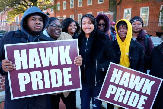 Vernon Johnson, left, a sophomore at the University of Maryland Eastern Shore, holds a sign at a rally in Annapolis  with other students on Wednesday, Nov. 13,in support of efforts to settle a federal lawsuit that is more than a decade old involving the state's four historically black colleges.