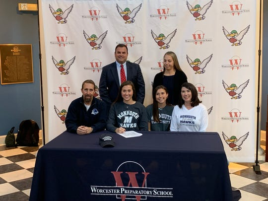 Abbi Nechay signs her national letter of intent to play field hockey at Monmouth University on Wednesday, Nov. 13, 2019.