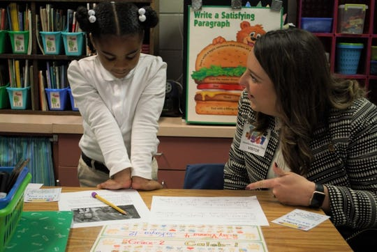 NIET Senior Program Specialist Lindsey Parker visits with students at Mansfield Elementary.