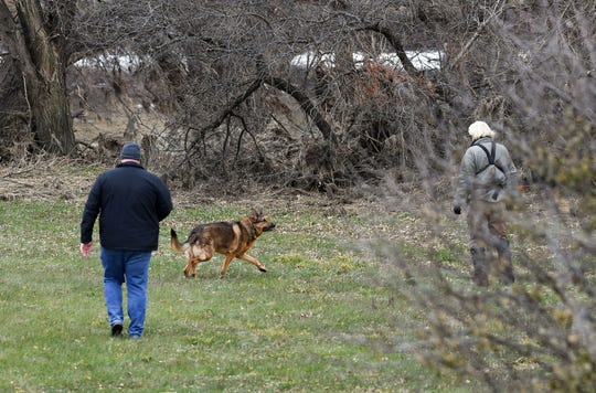 Jim Peters of Samaritan Detection Dogs and Detective Pat Mertes search for the remains of Ellabeth Lodermeier with Rocky, a trained German Shepherd, on Wednesday morning, Nov. 13, on the east side of Sioux Falls. Lodermeier has been missing for 45 years.