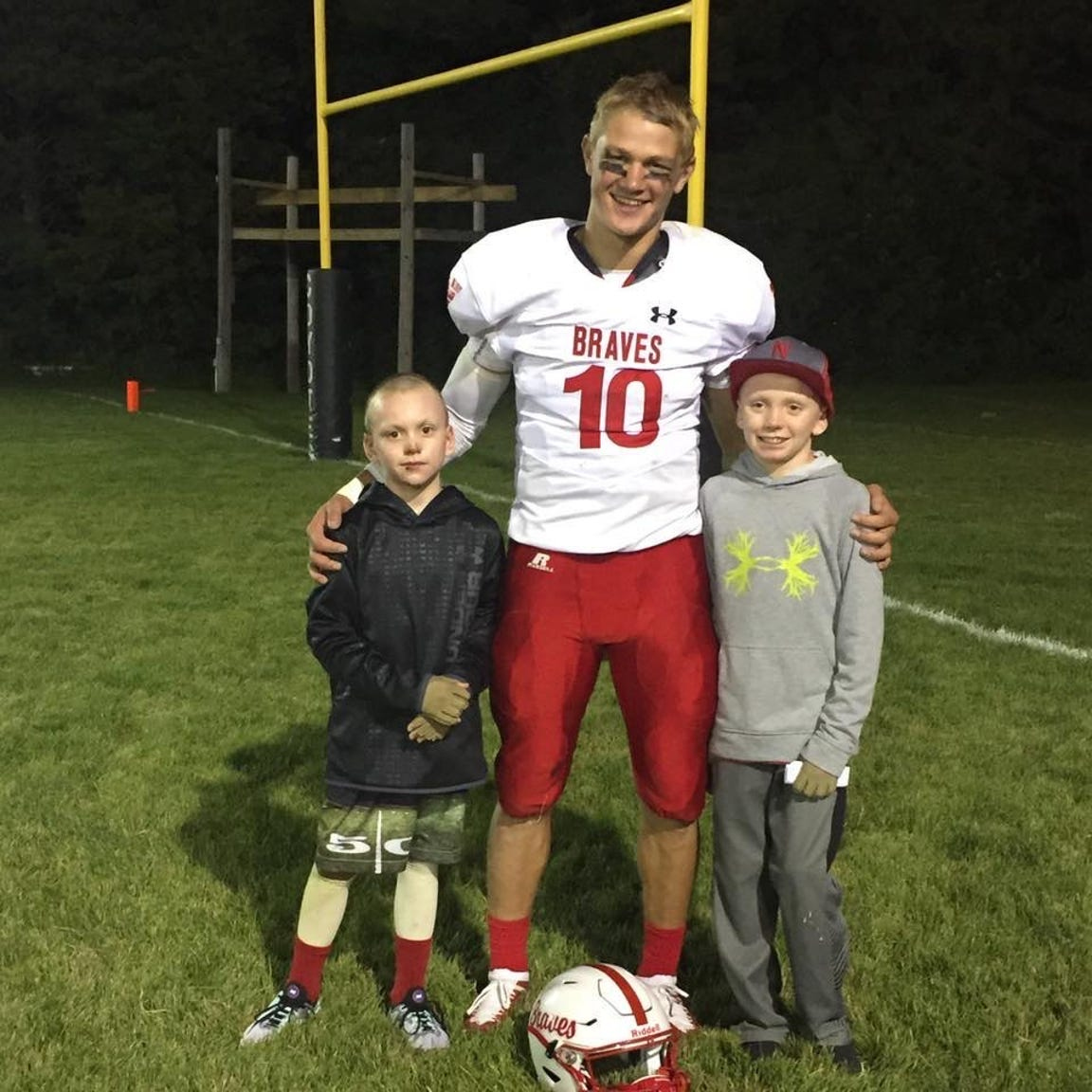 Britton-Hecla's Trevor Zuehlke poses for a photo with Easton Zuehlke and Lincoln Kilker.