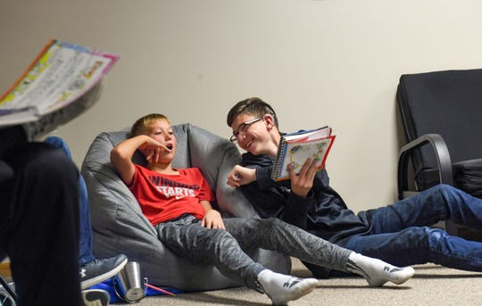 Trey Diedrich jokes with a friend during a youth group meeting on Wednesday, Oct. 2, 2019 at Trinity Lutheran Church in Mitchell. Trey is the only deaf student in this group.