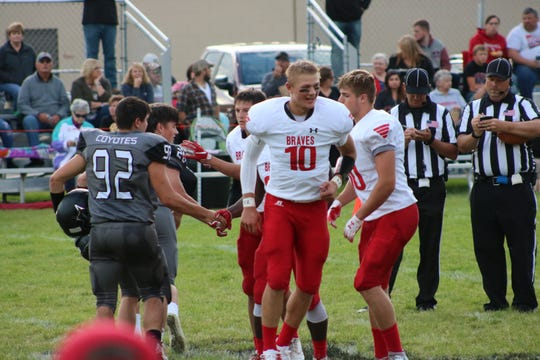 Britton-Hecla's Trevor Zuehlke runs back to the sideline after the coin toss.