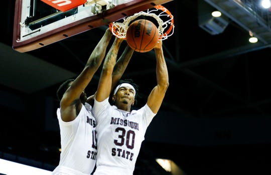 Missouri State senior Tulio Da Silva (30) dunks the ball as teammate senior Lamont West goes to the basket with him as the Bears take on the Cleveland State Vikings at JQH Arena on Tuesday, Nov. 12, 2019.