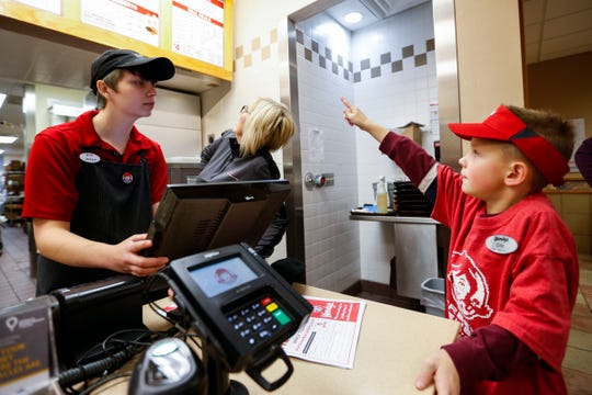 Seven-year-old Eric Johnson places an order at the end of his shift working at Wendy's on South Campbell Avenue on Monday, Nov. 11, 2019. Eric, who was diagnosed with autism at the age of 3, got the chance to work at the store after he told his mom that he wanted to be a manager at Wendy's for Career Day at school.