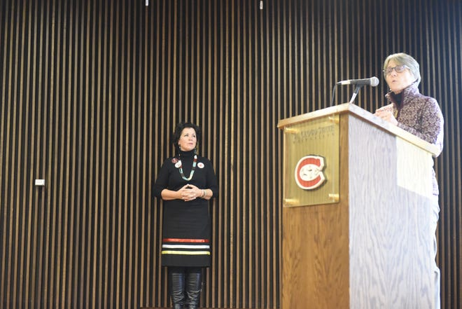 St. Cloud State University Robby Wacker (right) makes remarks about violence against women following a talk by SCSU grad and state Rep. Mary Kunesh-Podein, D-New Brighton, on campus Wednesday, Nov. 13, 2019.