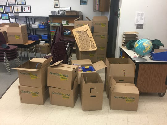 Brad Olson's classroom belongings packed into boxes