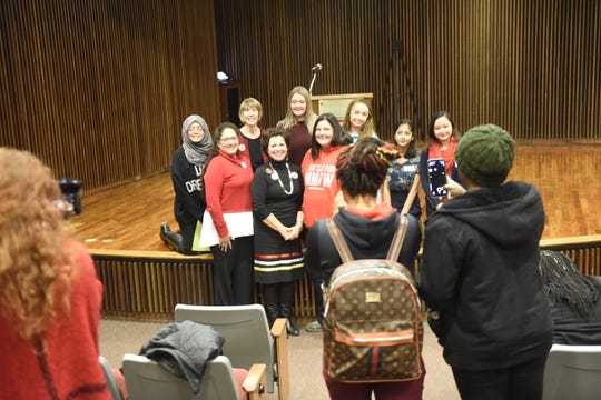 St. Cloud State University grad and state Rep. Mary Kunesh-Podein, D-New Brighton, (center, in black) takes photos with students and faculty including BearPaw Shields, on campus Wednesday, Nov. 13, 2019.